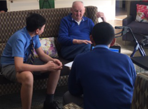 Canterbury Boys High students interviewing granparent